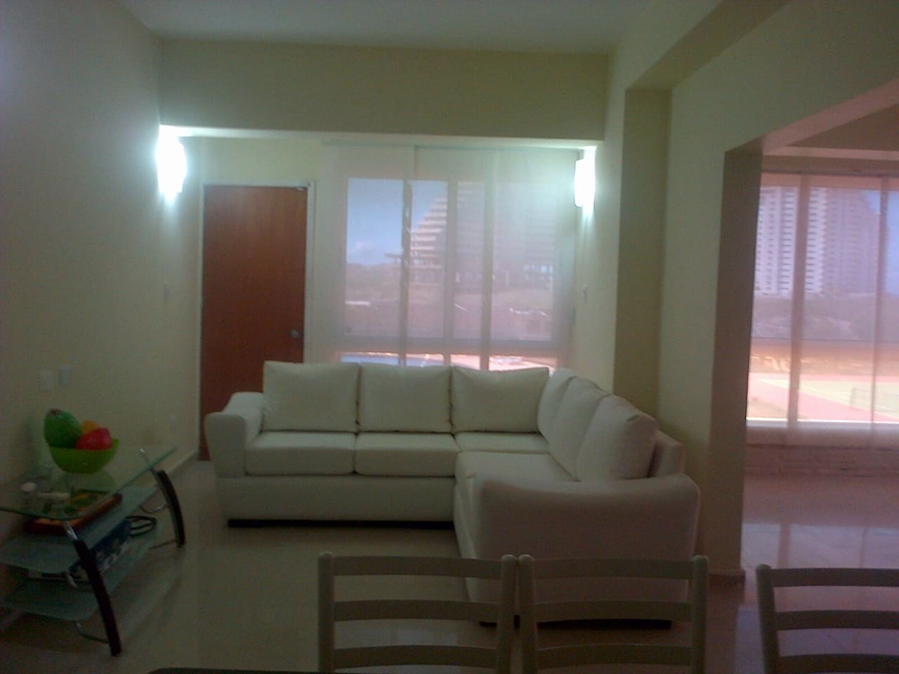 Spacious living room with TV and comfortable sofas