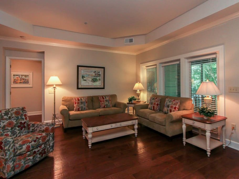 Spacious Living Room at 8116 Wendover Dunes has hardwood floors