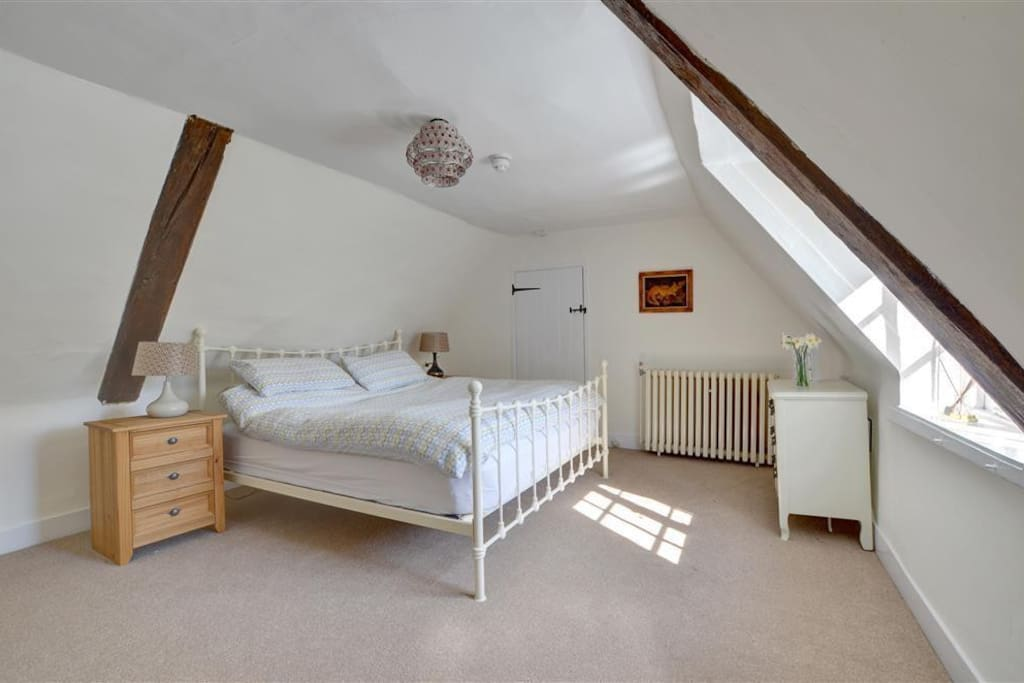 Large Double Bedroom with kingsize bed and view of the gardens