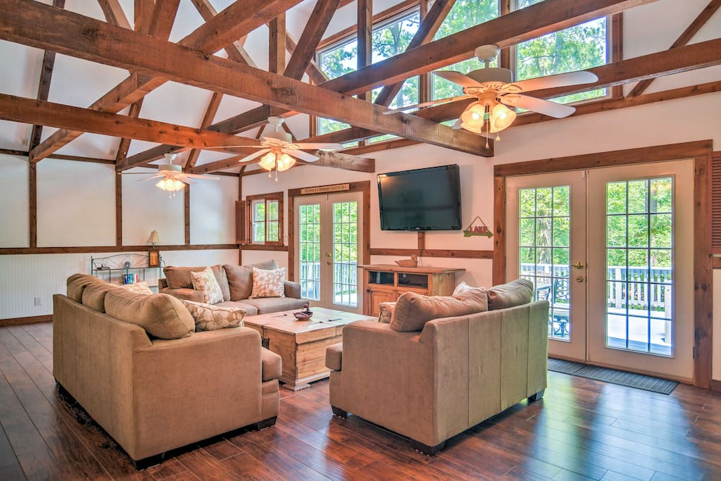 The interior of the home boasts exposed wooden beams and large windows.