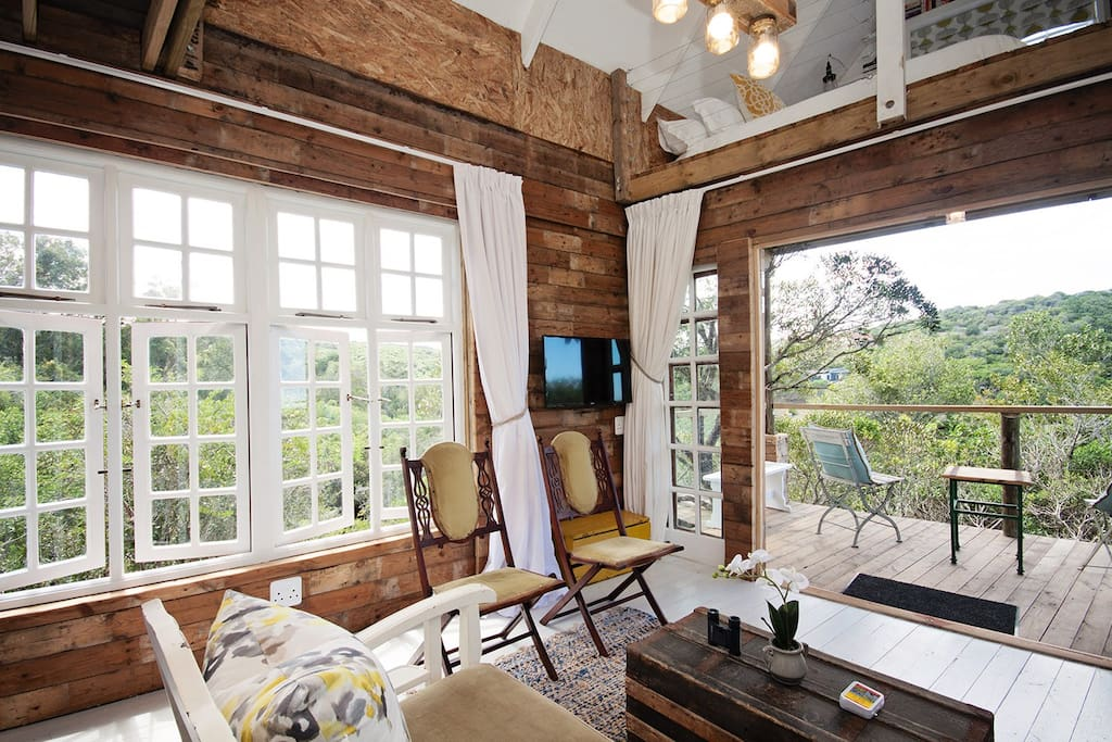Comfortable lounge area overlooking the tree tops