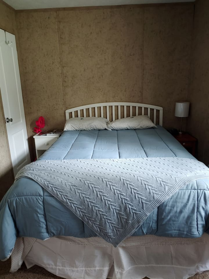 Queen size bed with memory foam mattress and a comfy comforter.