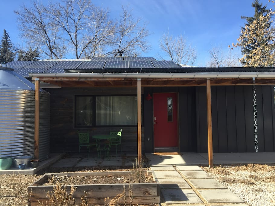Modern net-zero home has solar PV, solar thermal and ground source heat pump.