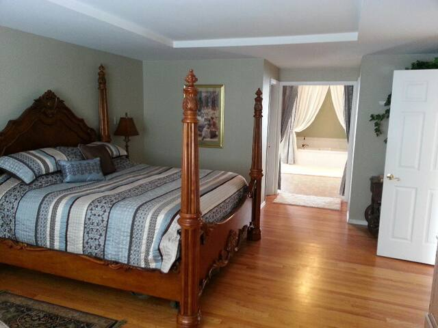 Master Bedroom and private luxury bath on main level.