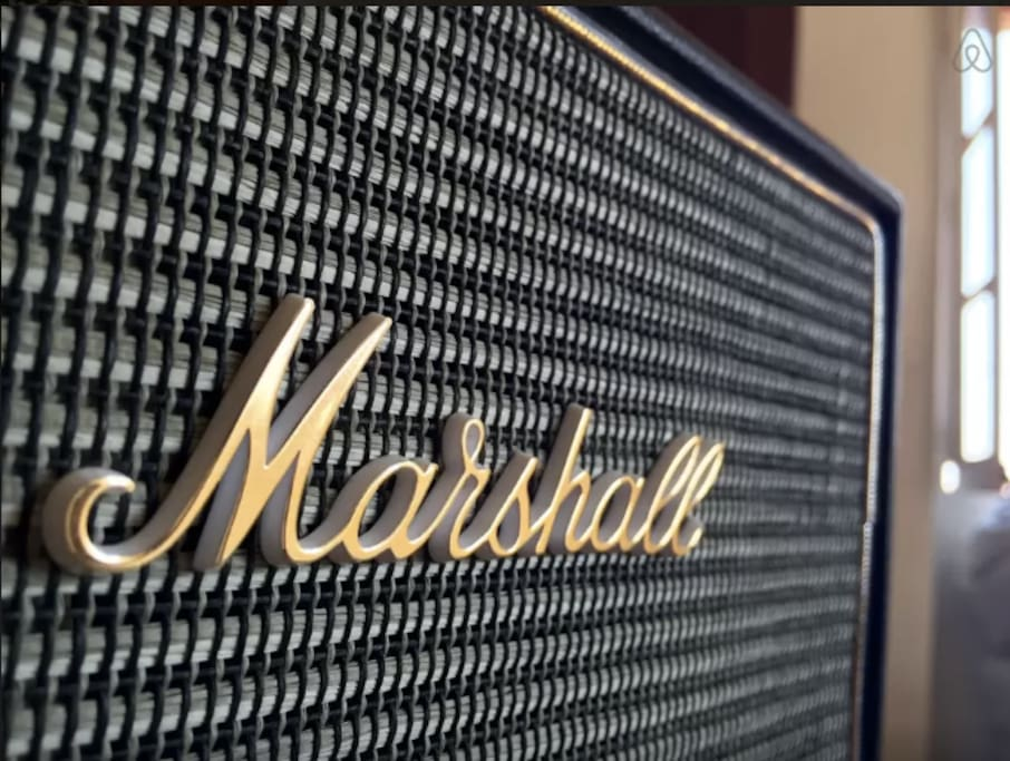 And a Marshall speaker, throwing deep bass through Bluetooth, or cable.