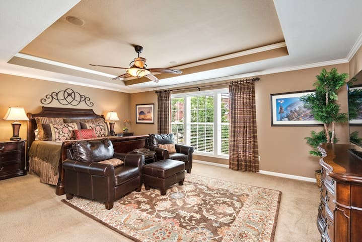 Sleep like a King in the upper master bedroom featuring a fancy steam shower & bath