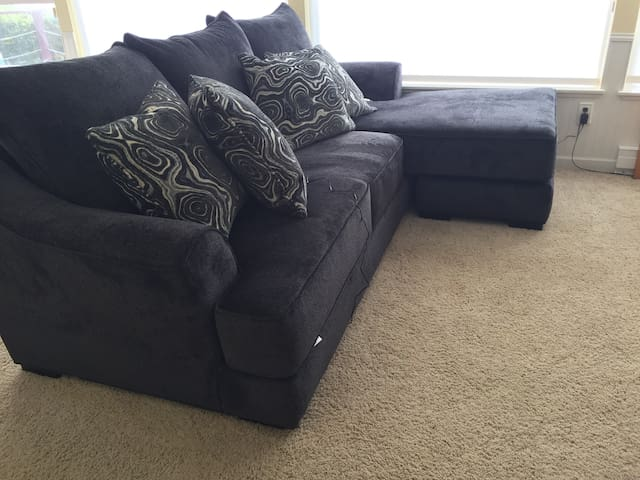 New sofa with chaise lounge and a perfect view to sleep with.  This is our extra person's sleeping space.