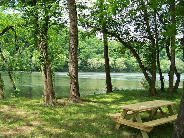 Picnic table down by the river (you cannot see river from house)