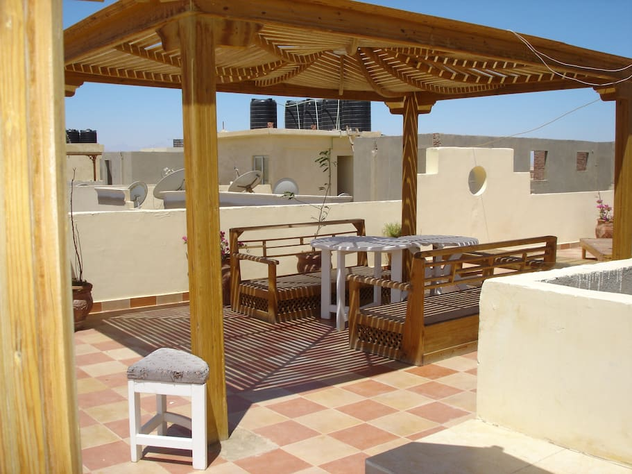 Large communal roof terrace, with sunbeds and pergolas