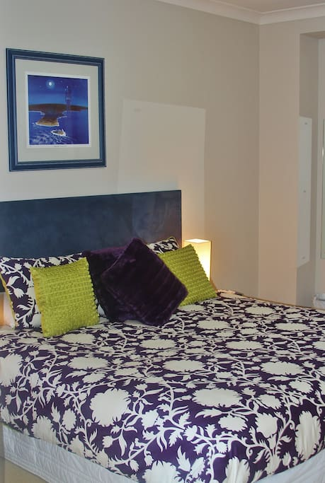 The bedroom is spacious with king sized bed and quality linen