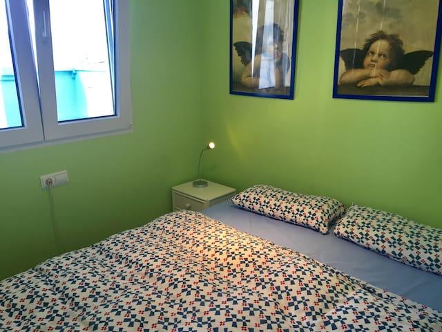 bedroom with queen size bed, sleeps 2