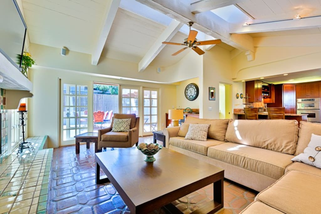 Enjoy this genteel Family Room with fireplace, outdoor access, large flat screen TV, and wet bar.