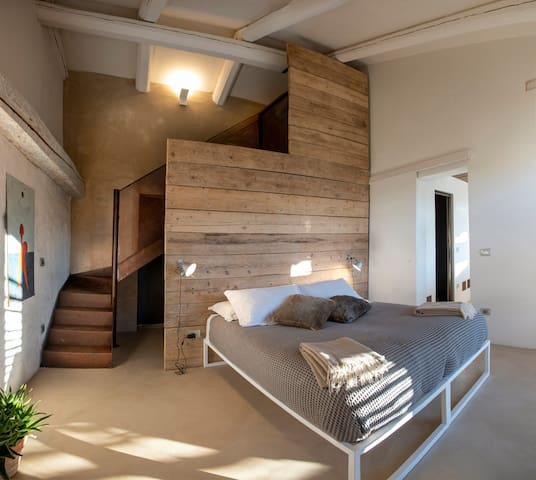 double bedroom with staircase leading to the mezzanine
