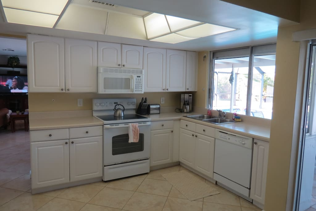 Fully Equipped Kitchen with View of Pool, Pass through Window