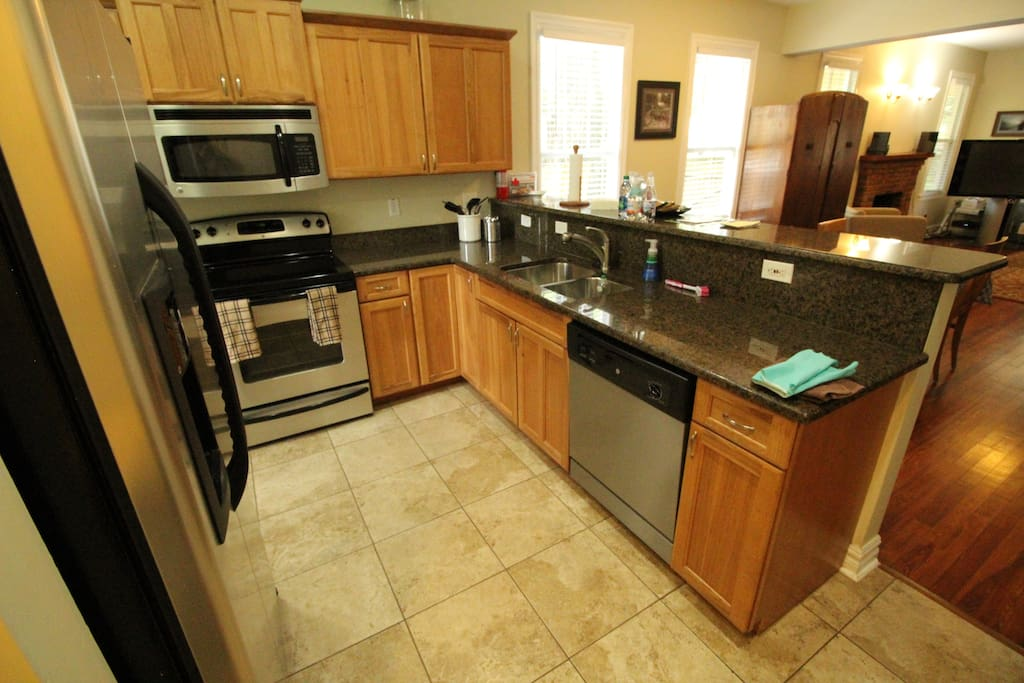 Kitchen appliances include dishwasher, microwave, oven, and Zojirushi hot water kettle, large fridge with filtered water, coffee makers and more.