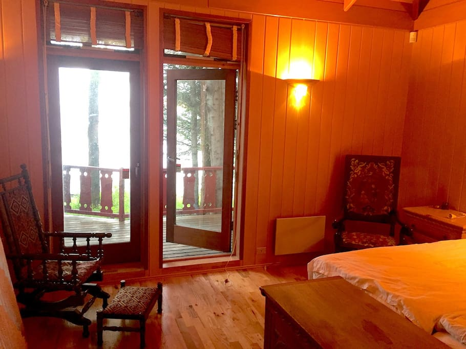 Master bedroom with entrance to terrace and spectacular view over lake Thingvallavatn.