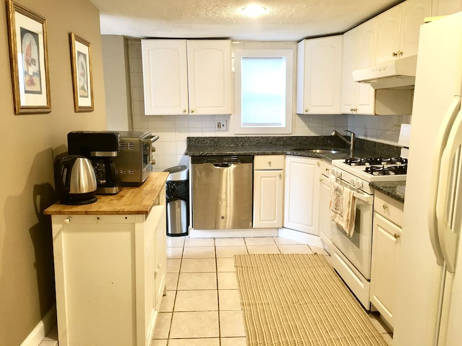 The kitchen is perfect for whipping up a quick meal or snack, as it boasts a full sized stove, gas range, microwave, and refrigerator