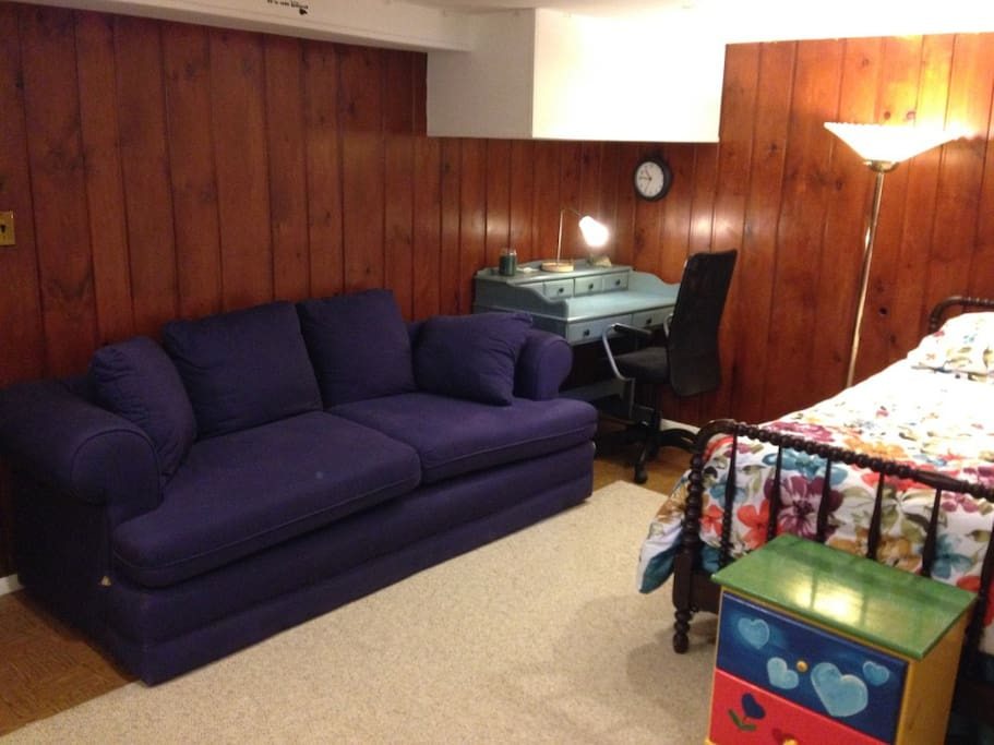 A couch and desk for lounging and studying.