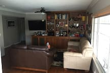 Family room with 47 inch TV for Spectrum TV and Netflix with surround sound. 2 couches, coffee table and ceiling fan.