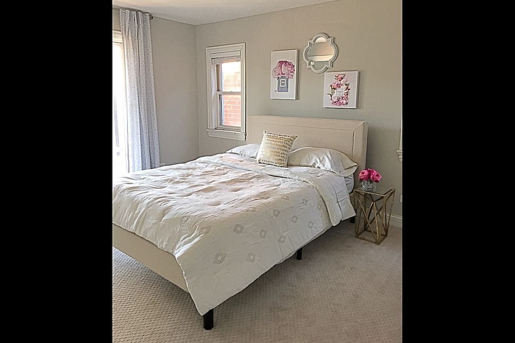 Master bedroom, queen size bed with new memory foam mattress and pillow top mattress pad. Ensuite bathroom to the right and sliding door to the balcony to the left.