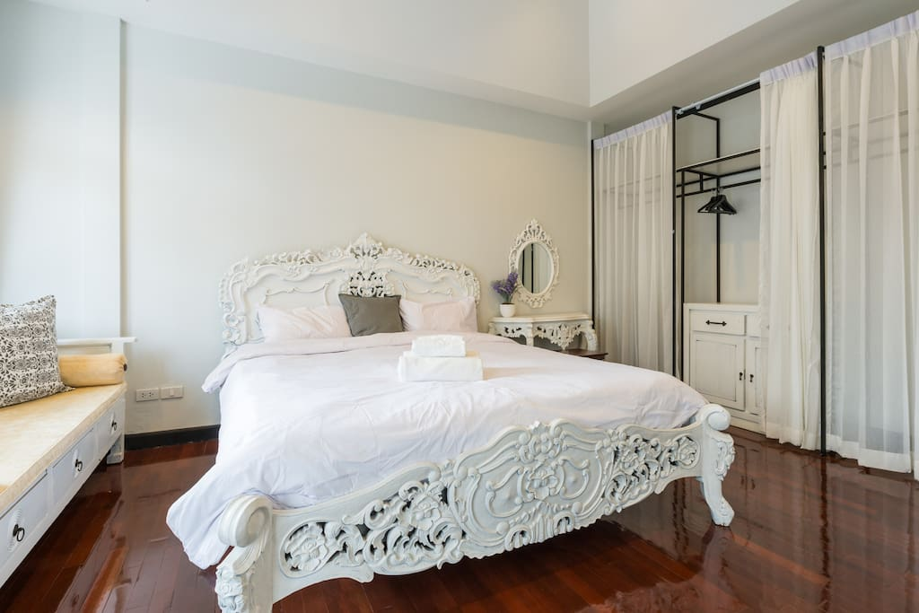 Bedroom suit with Master nice bathroom . This room is 4m x 5.5 m with craving teak wood King size bed , nice Daybed , Dressing table , Walk in closet , TV cabinet.