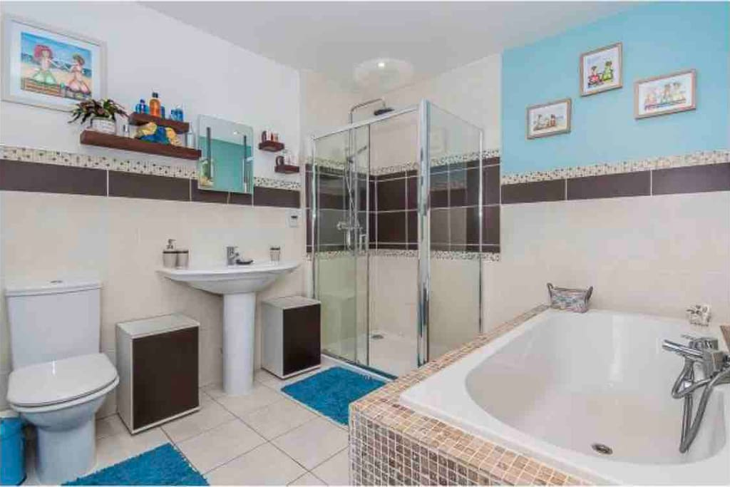 Shared bathroom with four piece suite including very large waterfall shower