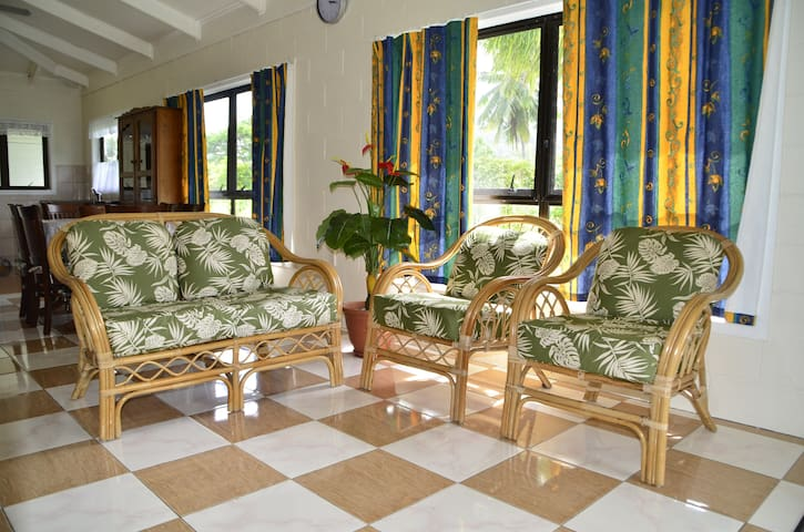 Sitting Room ~ a nice cool place for you to enjoy the cool breeze from surrounding windows.