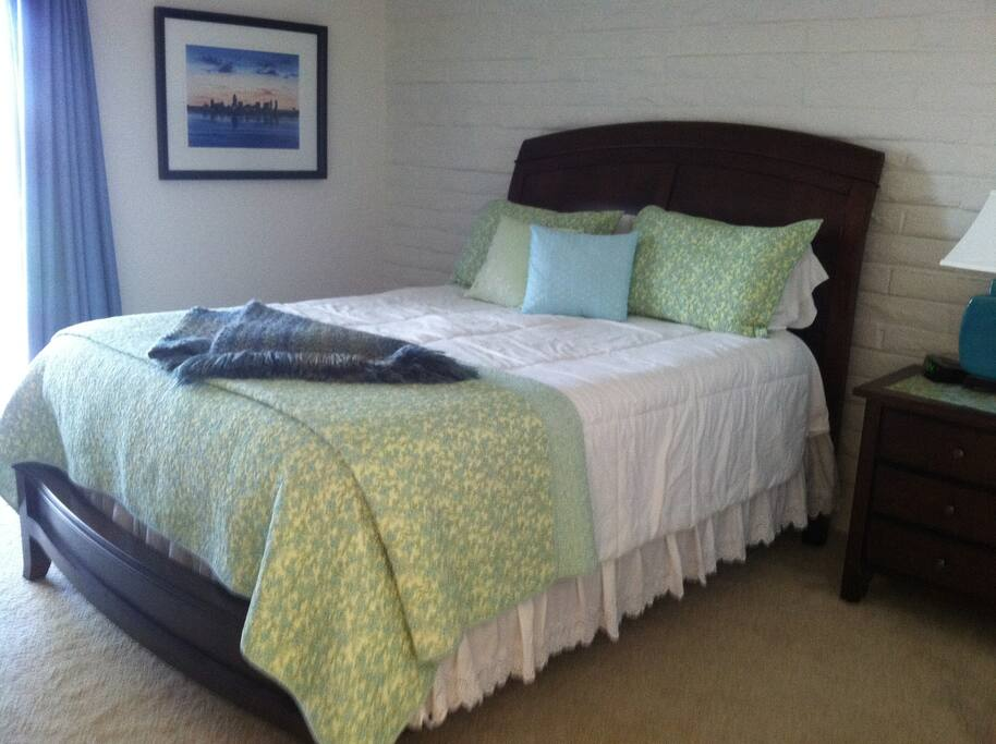 Queen size temperpedic mattress, extra large walk in closet, flat screen TV and access to private patio through sliding glass doors.