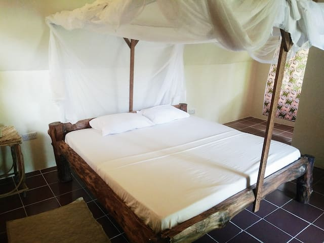 Double room with balcony @ East coast Zanzibar[07]