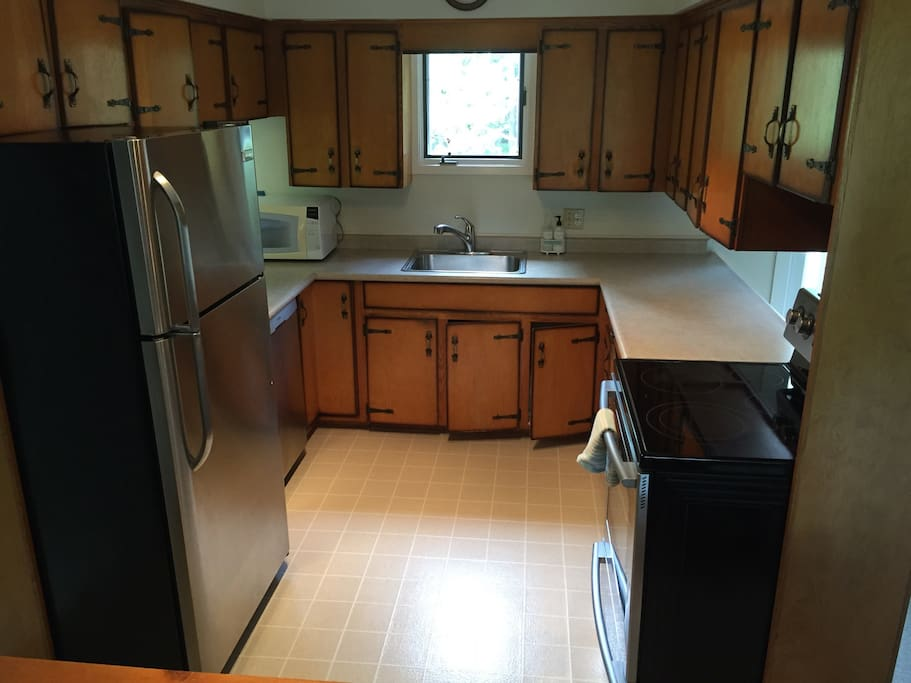 Compact, fully equipped kitchen with stainless appliances