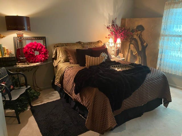 Outstanding guest bedroom with a queen bed and large closet.