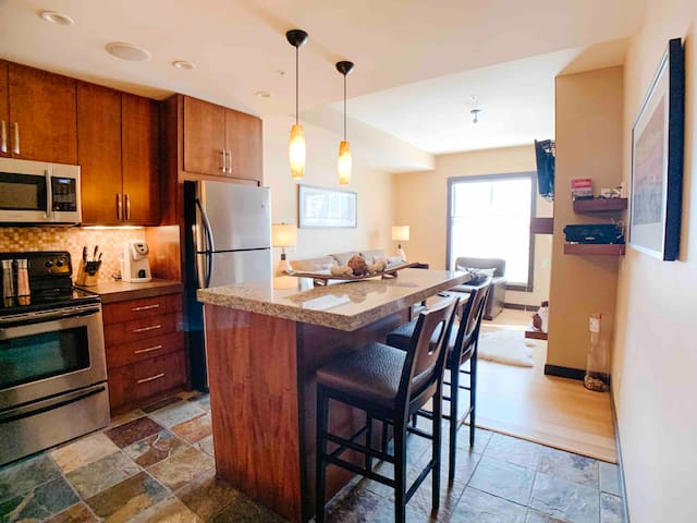 Kitchen with granite eat-in island