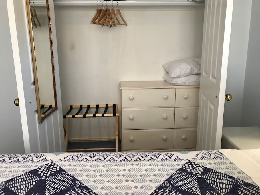 Spacious wardrobe with hanger, feather pillows and extra bedding