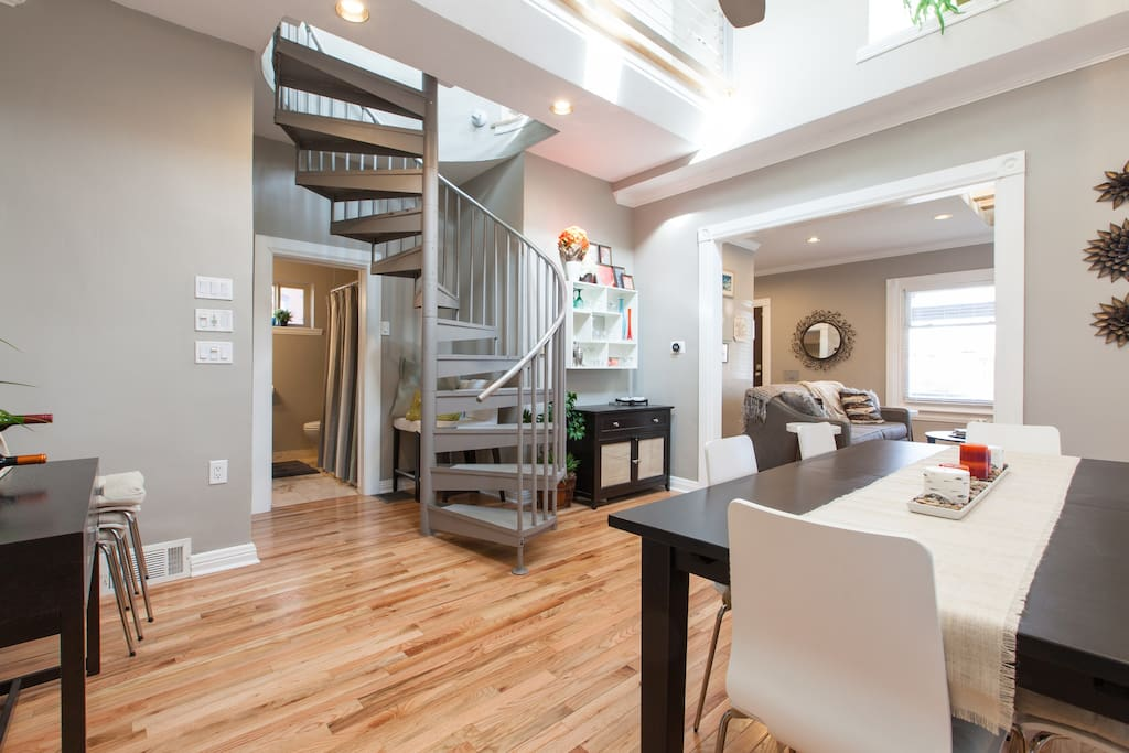 Great room with dining area. More skylights and fun architecture.