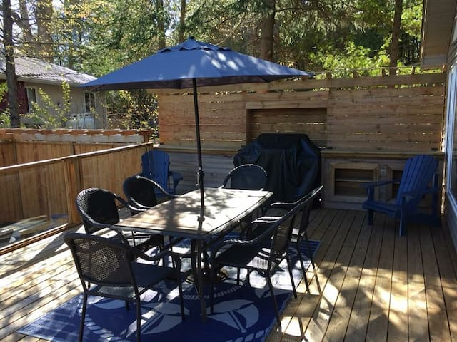 Outside dining area with BBQ