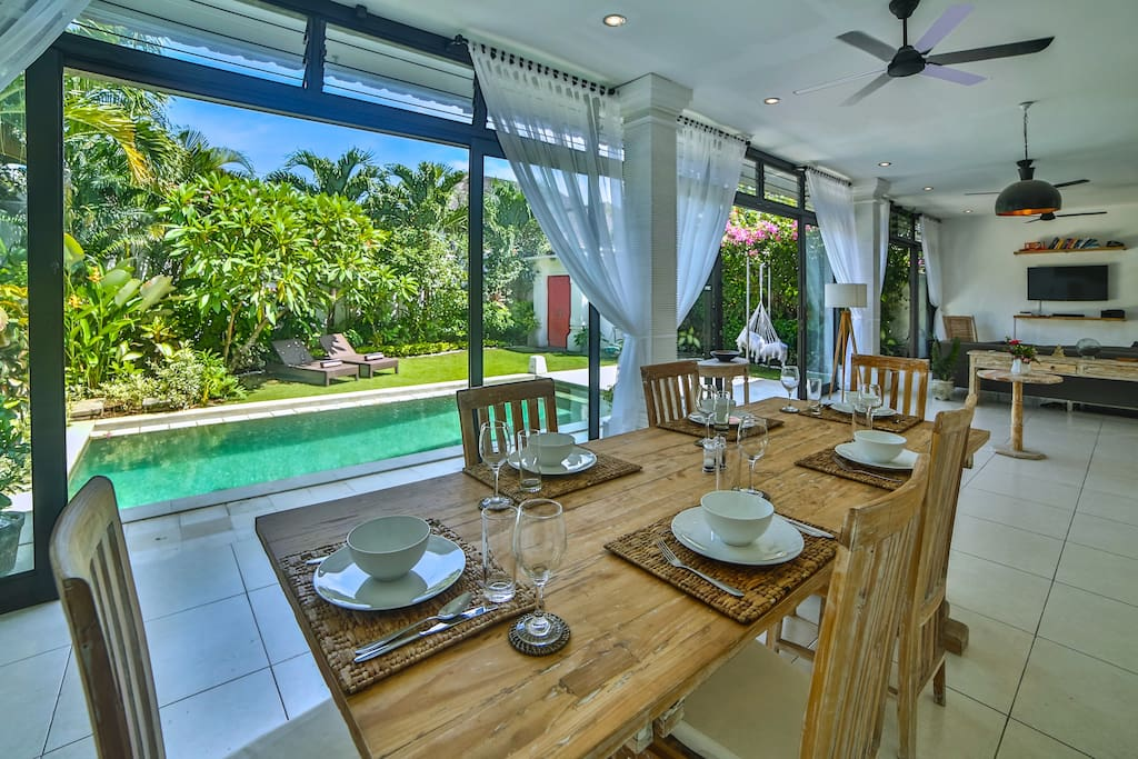 Dining room opens up to the swimming pool and gardens.