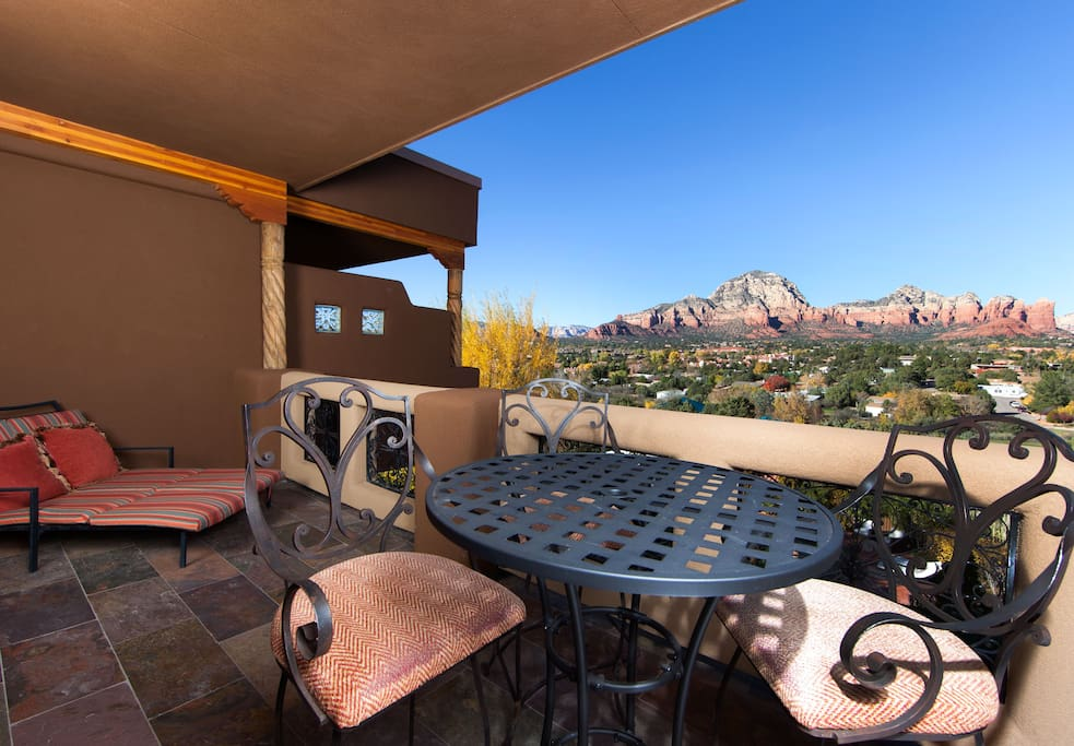 The best panoramic views of Sedona's red rocks right from outside your suite.  There is a large chaise lounge as well as dining table and chairs.