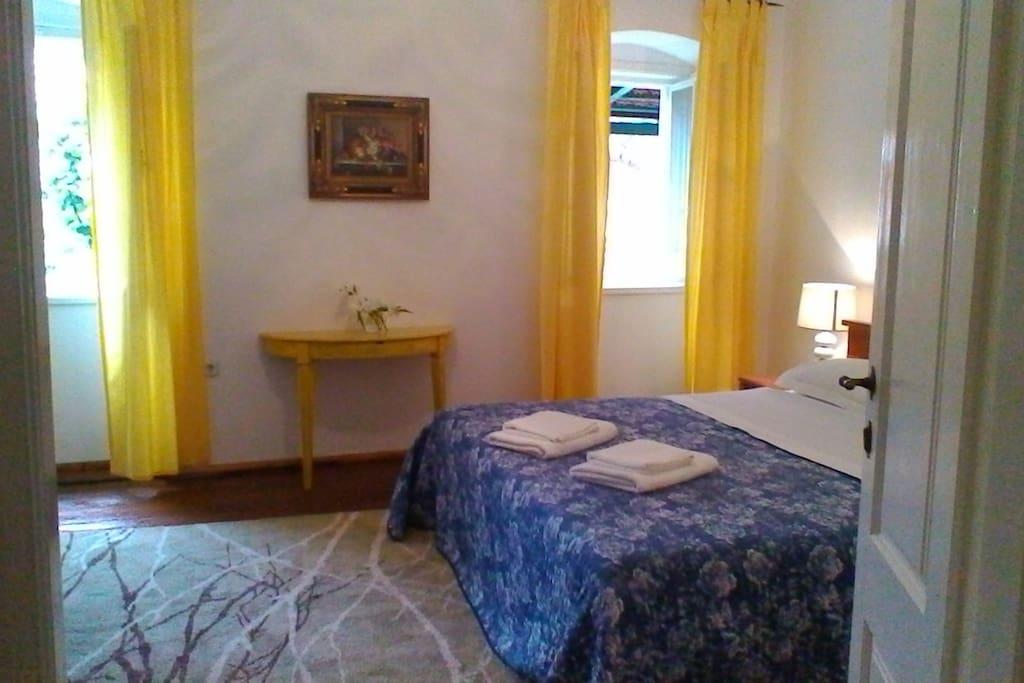 First Floor Master Bedroom over-looking the garden terrace.