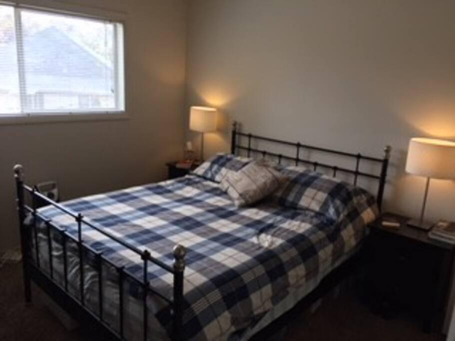 Sunny bedroom with queen bed