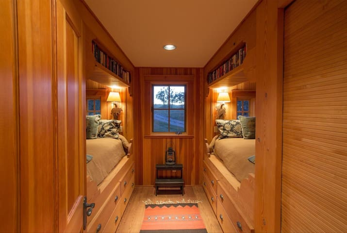 The very cool bunkroom with larger full matresses, 2 closets with spa robes & slippers, reading shelves and plenty of drawers with large spa towels.