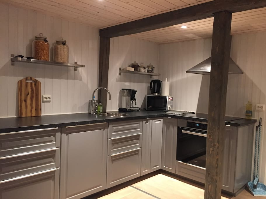 The kitchen is shared between the two rooms in the apartment.