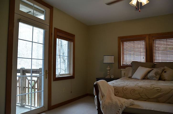 Master bedroom with king size bed and French door to the porch.