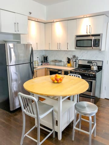 The kitchen is fully equipped with Fridge, Dishwasher, Microwave, 4 Burner stove and Oven and an island that doubles as a cozy dining area. We include all the utensils and crockery for a gourmet meal, or brew up a delicious coffee in the single-serve cappuccino maker.