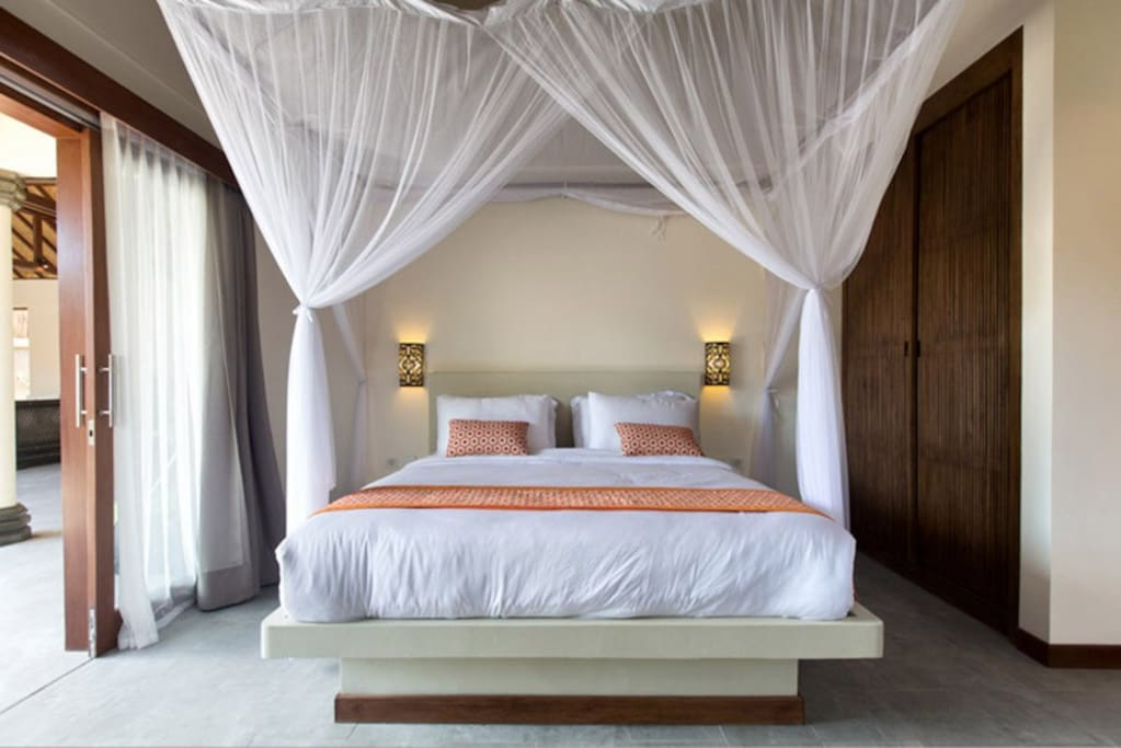 your room overlooks the pool. King size bed, ac, fan, mosquito net and private bathroom