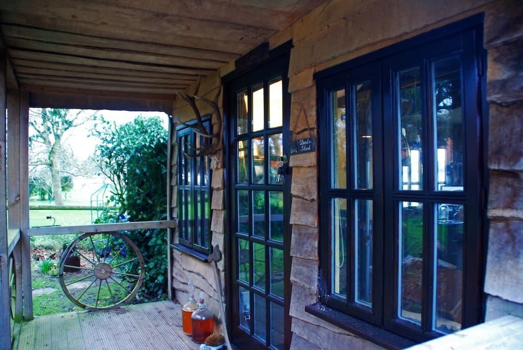 A view of the porch, with a very interesting shingle above the front door