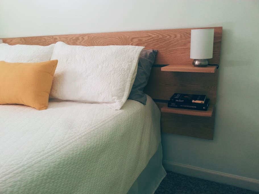 This new homemade headboard gives the cozy room a contemporary spin.