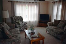 The living room is cozy and inviting, and there is plenty of comfortable seating.  Directv is provided.