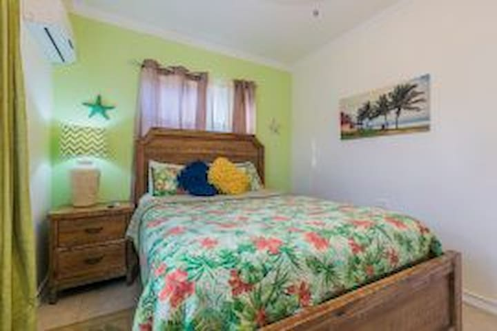 Soothing Queen size bed in Guest Room.