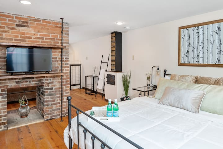 """Super comfortable semi firm queen mattress with new bedding. Lighting, power outlets, and USB chargers are readily available. A room divider """"door""""  is provided for when someone is utilizing the downstairs  sofa bed."""