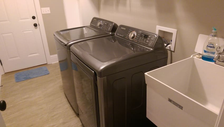 Washer and dryer in mudroom.